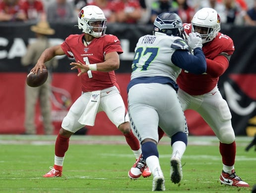 Sep 29, 2019; Glendale, AZ, USA; Arizona Cardinals quarterback Kyler Murray (1) passes the ball against the Seattle Seahawks during the first half at State Farm Stadium. Mandatory Credit: Joe Camporeale-USA TODAY Sports