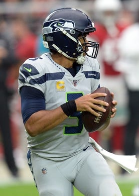 Sep 29, 2019; Glendale, AZ, USA; Seattle Seahawks quarterback Russell Wilson (3) drops back to pass against the Arizona Cardinals during the first half at State Farm Stadium. Mandatory Credit: Joe Camporeale-USA TODAY Sports