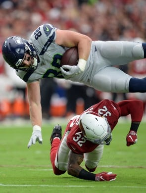 Sep 29, 2019; Glendale, AZ, USA; Arizona Cardinals strong safety Budda Baker (32) tackles Seattle Seahawks tight end Will Dissly (88) during the first half at State Farm Stadium. Mandatory Credit: Joe Camporeale-USA TODAY Sports