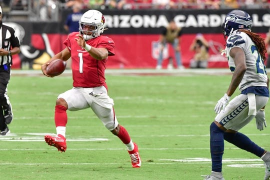 Sep 29, 2019; Glendale, AZ, USA; Arizona Cardinals quarterback Kyler Murray (1) runs for a first down as Seattle Seahawks cornerback Shaquill Griffin (26) defends during the first half at State Farm Stadium. Mandatory Credit: Matt Kartozian-USA TODAY Sports
