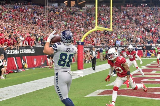 Sep 29, 2019; Glendale, AZ, USA; Seattle Seahawks tight end Will Dissly (88) catches a touchdown  pass as Arizona Cardinals cornerback Byron Murphy (33) defends during the first half at State Farm Stadium. Mandatory Credit: Matt Kartozian-USA TODAY Sports