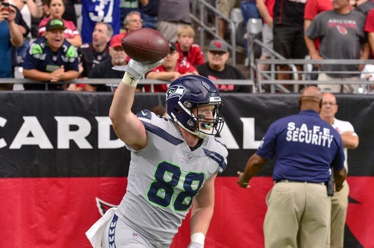 Sep 29, 2019; Glendale, AZ, USA; Seattle Seahawks tight end Will Dissly (88) celebrates after catching a touchdown  in the first half against the Arizona Cardinals at State Farm Stadium. Mandatory Credit: Matt Kartozian-USA TODAY Sports