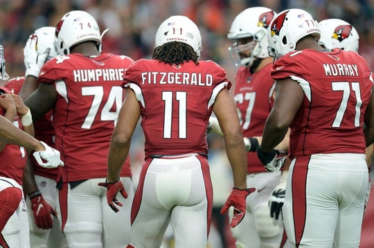 Sep 29, 2019; Glendale, AZ, USA; Arizona Cardinals wide receiver Larry Fitzgerald (11) huddles with teammates during the second half against the Seattle Seahawks at State Farm Stadium. Mandatory Credit: Joe Camporeale-USA TODAY Sports