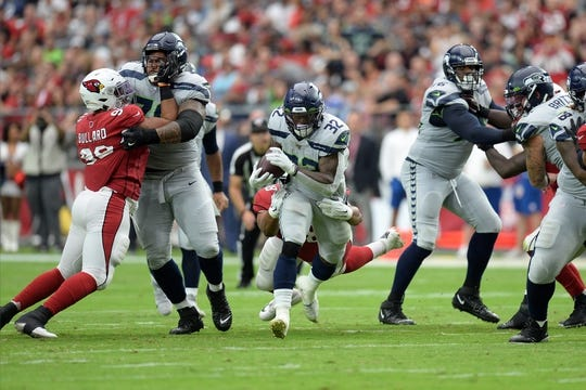 Sep 29, 2019; Glendale, AZ, USA; Seattle Seahawks running back Chris Carson (32) runs with the ball against the Arizona Cardinals during the first half at State Farm Stadium. Mandatory Credit: Joe Camporeale-USA TODAY Sports