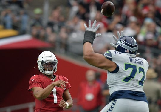 Sep 29, 2019; Glendale, AZ, USA; Arizona Cardinals quarterback Kyler Murray (1) throws the ball over the reach of Seattle Seahawks defensive tackle Al Woods (72) during the first half at State Farm Stadium. Mandatory Credit: Joe Camporeale-USA TODAY Sports