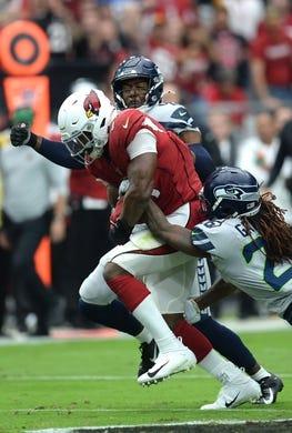 Sep 29, 2019; Glendale, AZ, USA; Seattle Seahawks cornerback Shaquill Griffin (26) tackles Arizona Cardinals running back David Johnson (31) during the first half at State Farm Stadium. Mandatory Credit: Joe Camporeale-USA TODAY Sports