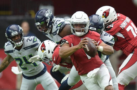 Sep 29, 2019; Glendale, AZ, USA; Arizona Cardinals quarterback Kyler Murray (1) scrambles against the Seattle Seahawks during the first half at State Farm Stadium. Mandatory Credit: Joe Camporeale-USA TODAY Sports