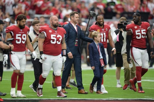 Sep 29, 2019; Glendale, AZ, USA; Former Arizona Cardinals quarterback Carson Palmer leads Cardinals players on to the field during the first half against the Seattle Seahawks at State Farm Stadium. Mandatory Credit: Joe Camporeale-USA TODAY Sports