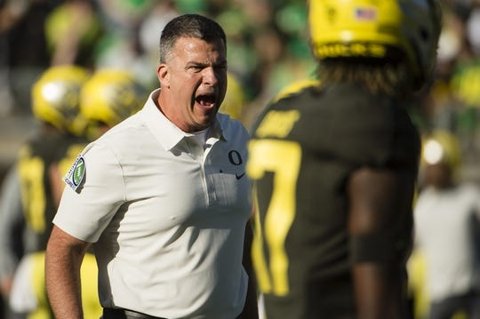 Oct 5, 2019; Eugene, OR, USA; Oregon Ducks head coach Mario Cristobal encourages his players during warm ups before a game against the California Golden Bears at Autzen Stadium. Mandatory Credit: Troy Wayrynen-USA TODAY Sports