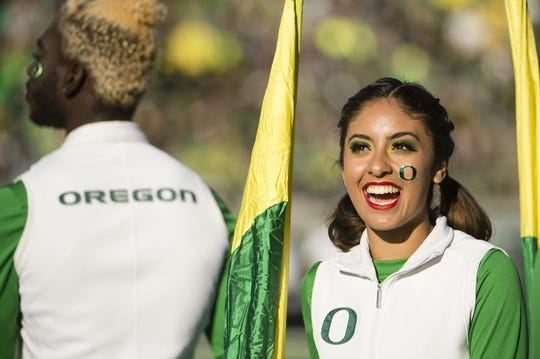 Oct 5, 2019; Eugene, OR, USA; An Oregon Ducks color guard smiles before performing before a game between the Oregon Ducks and the California Golden Bears at Autzen Stadium. Mandatory Credit: Troy Wayrynen-USA TODAY Sports
