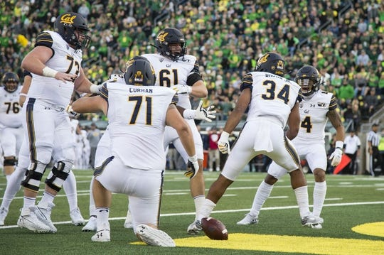 Oct 5, 2019; Eugene, OR, USA; California Golden Bears running back Christopher Brown Jr. (34) celebrates with teammates after scoring a touchdown during the first half against the Oregon Ducks at Autzen Stadium. Mandatory Credit: Troy Wayrynen-USA TODAY Sports