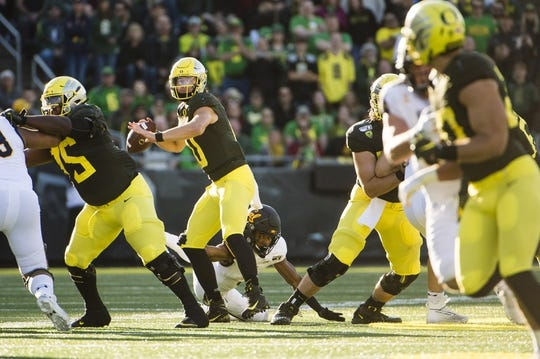 Oct 5, 2019; Eugene, OR, USA; Oregon Ducks quarterback Justin Herbert (10) throws a pass during the first half against the California Golden Bears at Autzen Stadium. Mandatory Credit: Troy Wayrynen-USA TODAY Sports
