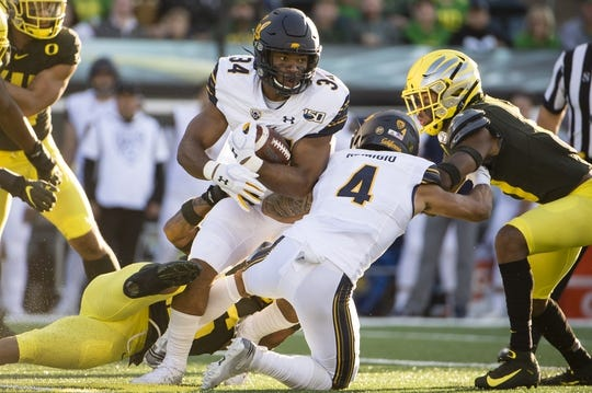 Oct 5, 2019; Eugene, OR, USA; California Golden Bears running back Christopher Brown Jr. (34) picks up yardage against the Oregon Ducks during the first half at Autzen Stadium. Mandatory Credit: Troy Wayrynen-USA TODAY Sports