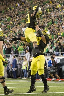 Oct 5, 2019; Eugene, OR, USA; Oregon Ducks running back Cyrus Habibi-Likio (33) celebrates with a teammate after scoring a touchdown during the second half against the California Golden Bears at Autzen Stadium. Oregon won the game 17-7. Mandatory Credit: Troy Wayrynen-USA TODAY Sports