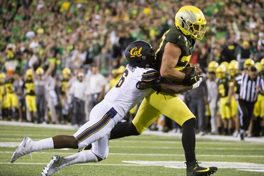 Oct 5, 2019; Eugene, OR, USA; Oregon Ducks tight end Jacob Breeland (27) drags California Golden Bears safety Jaylinn Hawkins (6) for a first down during the second half at Autzen Stadium. Oregon won the game 17-7. Mandatory Credit: Troy Wayrynen-USA TODAY Sports