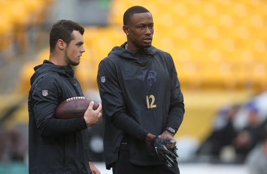 Oct 6, 2019; Pittsburgh, PA, USA; Baltimore Ravens quarterback Trace McSorley (7) and wide receiver Jaleel Scott (12) talk on the field before playing the Pittsburgh Steelers at Heinz Field. Mandatory Credit: Charles LeClaire-USA TODAY Sports