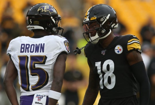 Oct 6, 2019; Pittsburgh, PA, USA; Baltimore Ravens wide receiver Marquise Brown (15) and Pittsburgh Steelers wide receiver Diontae Johnson (18) talk on the field before playing at Heinz Field. Mandatory Credit: Charles LeClaire-USA TODAY Sports