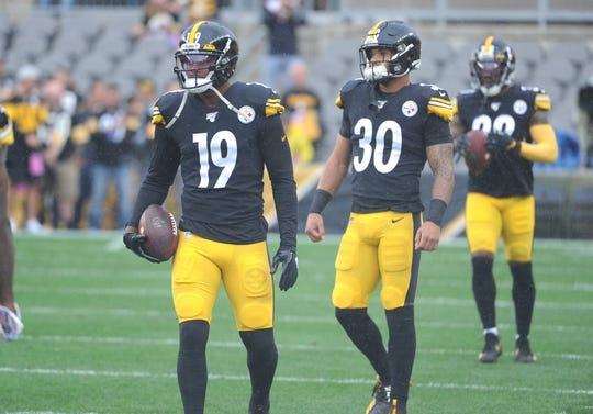 Oct 6, 2019; Pittsburgh, PA, USA; Pittsburgh Steelers wide receiver JuJu Smith-Schuster (19) and running back James Conner (30) warm up before a game against the Baltimore Ravens at Heinz Field. Mandatory Credit: Philip G. Pavely-USA TODAY Sports