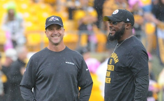 Oct 6, 2019; Pittsburgh, PA, USA; Baltimore Ravens head coach John Harbaugh (left) talks with Pittsburgh Steelers head coach Mike Tomlin before a game at Heinz Field. Mandatory Credit: Philip G. Pavely-USA TODAY Sports