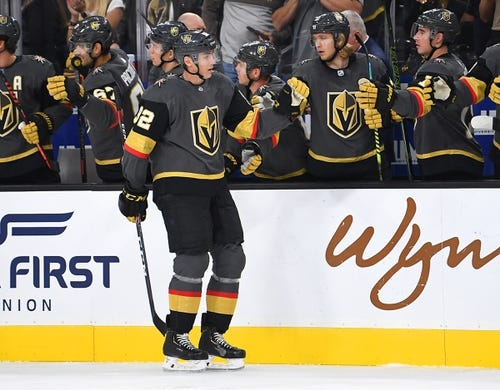 Oct 12, 2019; Las Vegas, NV, USA; Vegas Golden Knights left wing Tomas Nosek (92) celebrates with team mates after scoring a first period goal against the Calgary Flames at T-Mobile Arena. Mandatory Credit: Stephen R. Sylvanie-USA TODAY Sports
