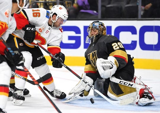 Oct 12, 2019; Las Vegas, NV, USA; Vegas Golden Knights goaltender Marc-Andre Fleury (29) stops Calgary Flames center Tobias Rieder (16) during the first period at T-Mobile Arena. Mandatory Credit: Stephen R. Sylvanie-USA TODAY Sports