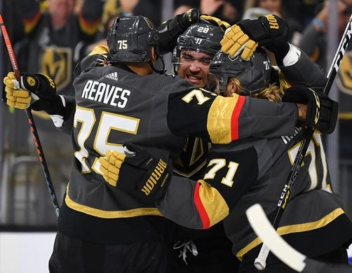 Oct 12, 2019; Las Vegas, NV, USA; Vegas Golden Knights left wing William Carrier (28) celebrates with right wing Ryan Reaves (75) and center William Karlsson (71) after scoring a second period goal against the Calgary Flames at T-Mobile Arena. Mandatory Credit: Stephen R. Sylvanie-USA TODAY Sports
