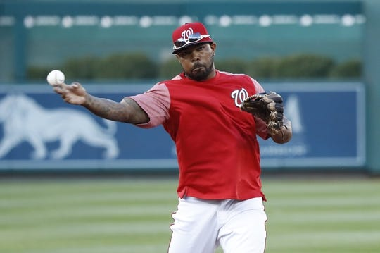 Oct 15, 2019; Washington, DC, USA; Washington Nationals second baseman Howie Kendrick throws the ball during batting practice prior to the Nationals  game against the St. Louis Cardinals in game four of the 2019 NLCS playoff baseball series at Nationals Park. Mandatory Credit: Geoff Burke-USA TODAY Sports