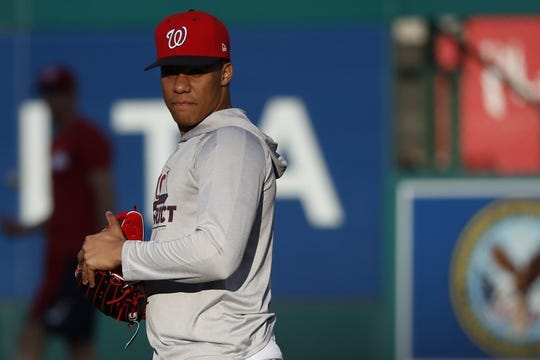 Oct 15, 2019; Washington, DC, USA; Washington Nationals left fielder Juan Soto stands on the field during batting practice prior to the Nationals  game against the St. Louis Cardinals in game four of the 2019 NLCS playoff baseball series at Nationals Park. Mandatory Credit: Geoff Burke-USA TODAY Sports