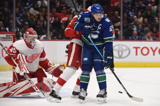 Oct 15, 2019; Vancouver, British Columbia, CAN; Vancouver Canucks forward Bo Horvat (53) screens Detroit Red Wings goaltender Jonathan Bernier (45) during the first period at Rogers Arena. Mandatory Credit: Anne-Marie Sorvin-USA TODAY Sports