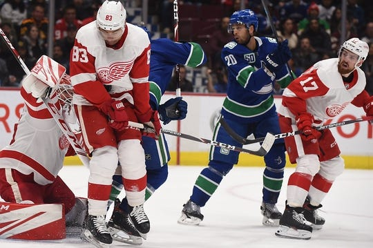 Oct 15, 2019; Vancouver, British Columbia, CAN; Detroit Red Wings defenseman Trevor Daley (83) blocks a shot on net against Detroit Red Wings goaltender Jonathan Bernier (45) by the Vancouver Canucks during the first period at Rogers Arena. Mandatory Credit: Anne-Marie Sorvin-USA TODAY Sports
