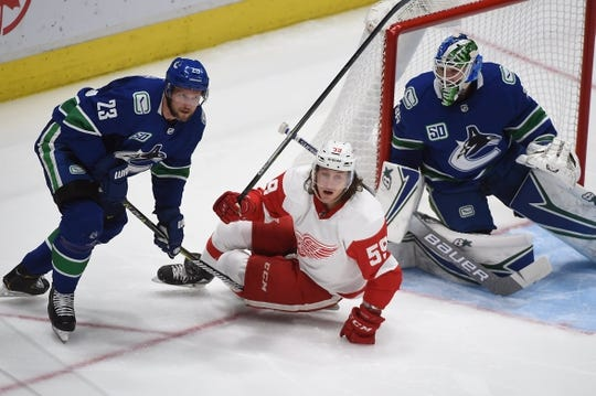 Oct 15, 2019; Vancouver, British Columbia, CAN; Vancouver Canucks defenseman Alexander Edler (23) defends against Detroit Red Wings forward Tyler Bertuzzi (59) during the second period at Rogers Arena. Mandatory Credit: Anne-Marie Sorvin-USA TODAY Sports