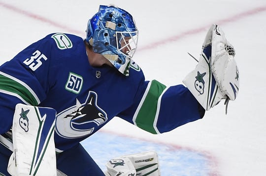 Oct 15, 2019; Vancouver, British Columbia, CAN; Vancouver Canucks goaltender Thatcher Demko (35) stops a shot on net by the Detroit Red Wings during the second period at Rogers Arena. Mandatory Credit: Anne-Marie Sorvin-USA TODAY Sports