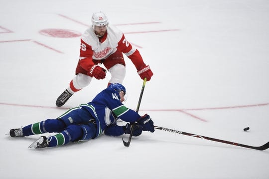 Oct 15, 2019; Vancouver, British Columbia, CAN; Detroit Red Wings defenseman Mike Green (25) trips Vancouver Canucks defenseman Quinn Hughes (43) during the second period at Rogers Arena. Mandatory Credit: Anne-Marie Sorvin-USA TODAY Sports