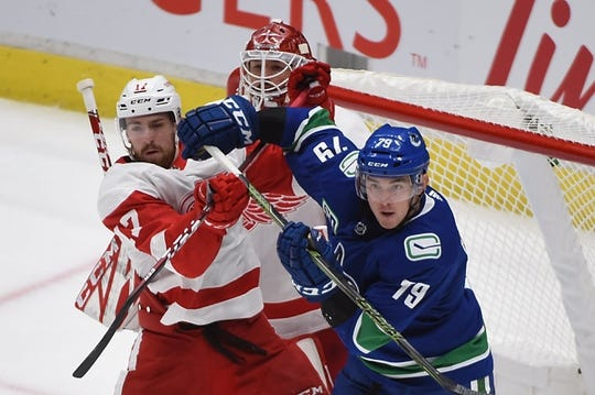 Oct 15, 2019; Vancouver, British Columbia, CAN; Detroit Red Wings defenseman Filip Hronek (17) defends against Vancouver Canucks forward Micheal Ferland (79) during the second period at Rogers Arena. Mandatory Credit: Anne-Marie Sorvin-USA TODAY Sports