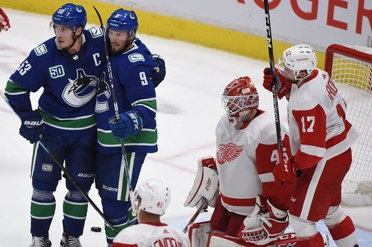 Oct 15, 2019; Vancouver, British Columbia, CAN; Vancouver Canucks forward J.T. Miller (9) celebrates his goal against Detroit Red Wings goaltender Jonathan Bernier (45) with forward Bo Horvat (53) during the second period at Rogers Arena. Mandatory Credit: Anne-Marie Sorvin-USA TODAY Sports