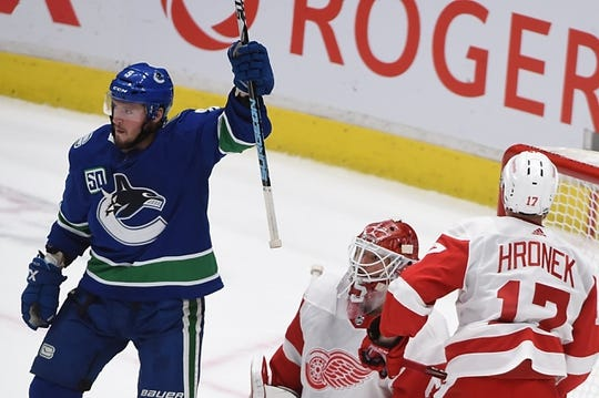 Oct 15, 2019; Vancouver, British Columbia, CAN; Vancouver Canucks forward J.T. Miller (9) celebrates his goal against Detroit Red Wings goaltender Jonathan Bernier (45) during the second period at Rogers Arena. Mandatory Credit: Anne-Marie Sorvin-USA TODAY Sports