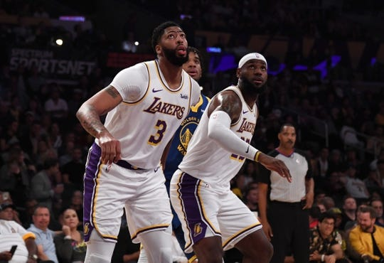 Oct 16, 2019; Los Angeles, CA, USA; Los Angeles Lakers forward Anthony Davis (3) and forward LeBron James (23)  in the first half against the Golden State Warriors at Staples Center. Mandatory Credit: Kirby Lee-USA TODAY Sports