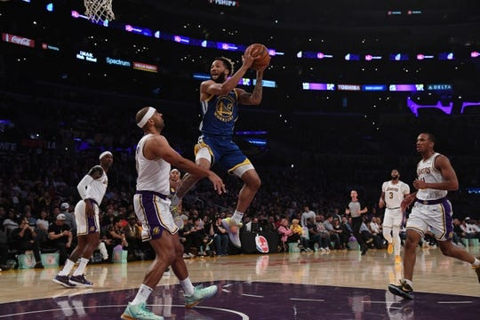 Oct 16, 2019; Los Angeles, CA, USA; Golden State Warriors guard Ky Bowman (12) is defended by Los Angeles Lakers forward Jared Dudley (10) in the first half at Staples Center. Mandatory Credit: Kirby Lee-USA TODAY Sports