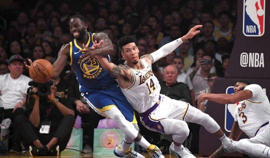 Oct 16, 2019; Los Angeles, CA, USA; Golden State Warriors forward Draymond Green (23) and Los Angeles Lakers guard Danny Green (14) battle for the ball in the first half at Staples Center. Mandatory Credit: Kirby Lee-USA TODAY Sports