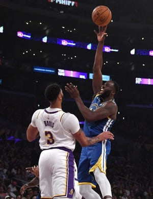 Oct 16, 2019; Los Angeles, CA, USA; Golden State Warriors forward Draymond Green (23) is defended by Los Angeles Lakers forward Anthony Davis (3)  in the first half at Staples Center. Mandatory Credit: Kirby Lee-USA TODAY Sports