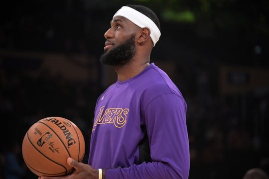 Oct 16, 2019; Los Angeles, CA, USA; Los Angeles Lakers forward LeBron James holds a basketball  in the first half against the Golden State Warriors at Staples Center. The Lakers defeated the Warriors 126-93. Mandatory Credit: Kirby Lee-USA TODAY Sports