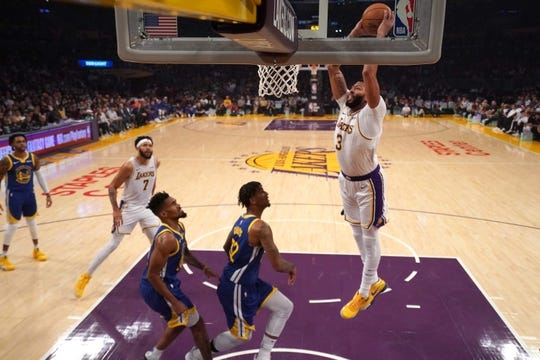 Oct 16, 2019; Los Angeles, CA, USA; Los Angeles Lakers forward Anthony Davis (3) dunks the ball against the Golden State Warriors  in the second half half at Staples Center. Mandatory Credit: Kirby Lee-USA TODAY Sports