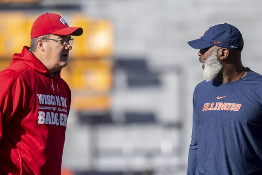 Oct 19, 2019; Champaign, IL, USA; Wisconsin Badgers head coach Paul Chryst and Illinois Fighting Illini head coach Lovie Smith chat prior to the first half at Memorial Stadium. Mandatory Credit: Patrick Gorski-USA TODAY Sports