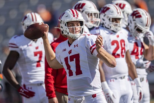 Oct 19, 2019; Champaign, IL, USA; Wisconsin Badgers quarterback Jack Coan (17) warms up prior to the first half against the Illinois Fighting Illini at Memorial Stadium. Mandatory Credit: Patrick Gorski-USA TODAY Sports