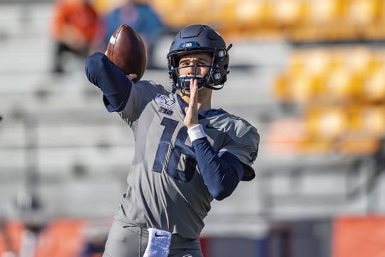 Oct 19, 2019; Champaign, IL, USA; Illinois Fighting Illini quarterback Brandon Peters (18) warms up prior to the first half against the Wisconsin Badgers at Memorial Stadium. Mandatory Credit: Patrick Gorski-USA TODAY Sports