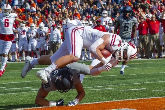 Oct 19, 2019; Champaign, IL, USA; Wisconsin Badgers tight end Jake Ferguson (84) runs in for a touchdown as Illinois Fighting Illini defensive back Sydney Brown (30) tackles during the first half at Memorial Stadium. Mandatory Credit: Patrick Gorski-USA TODAY Sports