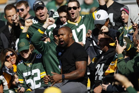 Oct 20, 2019; Green Bay, WI, USA; Former Green Bay Packers and Oakland Raiders player Charles Woodson cheers with fans prior to the game at Lambeau Field. Mandatory Credit: Jeff Hanisch-USA TODAY Sports