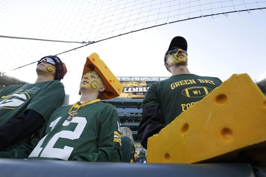 Oct 20, 2019; Green Bay, WI, USA; Green Bay Packers fans Gannon Blankenship (left), Gage Blankenship (center) and Doyle Blankenship (right) watch players warm up prior to the game against the Oakland Raiders at Lambeau Field. Mandatory Credit: Dan Powers/Wisconsin via USA TODAY Sports