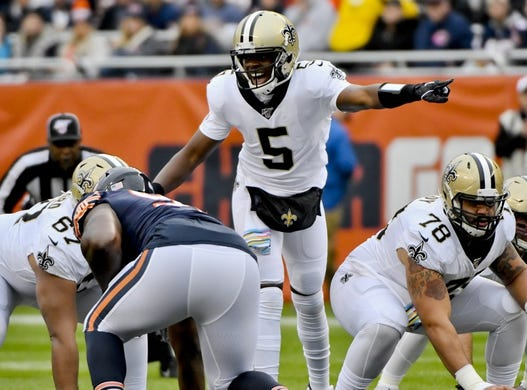 Oct 20, 2019; Chicago, IL, USA; New Orleans Saints quarterback Teddy Bridgewater (5) yells to the team against the Chicago Bears in the first half at Soldier Field. Mandatory Credit: Matt Marton-USA TODAY Sports