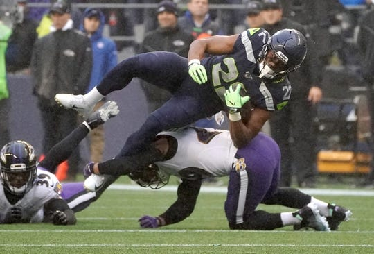 Oct 20, 2019; Seattle, WA, USA; Seattle Seahawks running back C.J. Prosise (22) is tackled by Baltimore Ravens free safety Earl Thomas (29) in the second quarter at CenturyLink Field. Mandatory Credit: Kirby Lee-USA TODAY Sports